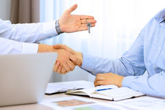 Real-estate agent signing a contract. Handshake between two business people Royalty Free Stock Images