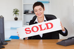 Real estate agent with a sold panel Stock Photography
