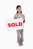 Real estate agent with sold sign Stock Photos