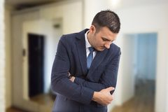 Real estate agent suffering elbow pain stock image