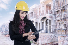 Real estate agent with tablet at construction site Stock Photos