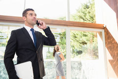 Real-estate agent talking on the mobile phone Royalty Free Stock Photos
