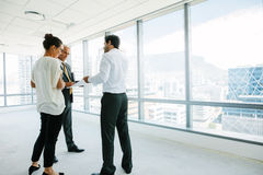 Real estate agent talking with potential clients at new office s royalty free stock image