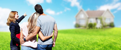 Real Estate agent woman with clients near new house. stock photography