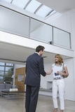 Real Estate Agent And Woman Shaking Hands In New Home royalty free stock images