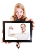 Real estate agent woman showing keys on tablet. Royalty Free Stock Photos