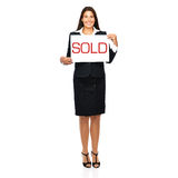 Real estate agent woman sold. Businesswoman holding sold sign. Isolated on a withe background Royalty Free Stock Images