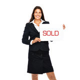 Real estate agent woman sold. Businesswoman holding sold sign. Isolated on a withe background Stock Images