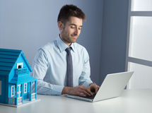 Real estate agent at work Royalty Free Stock Photos