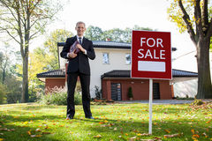 Real estate agent in work. Young and handsome real estate agent in work Stock Photos