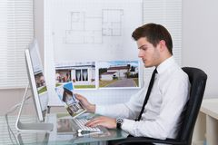 Real estate agent working on computer Royalty Free Stock Photos