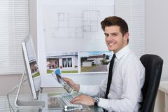 Real estate agent working on computer Royalty Free Stock Images