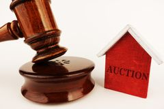 Real estate auction concept with small model house and wooden gavel royalty free stock photos
