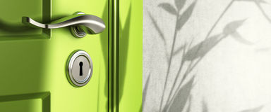 Real estate banner, door handle. Home entrance, close up of a handle and keyhole, green door and a wall, shadow of leaves Royalty Free Stock Photography