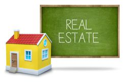 Real estate on blackboard Stock Images