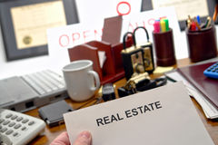 Real Estate Blank Document in Hand on Realtor Desk Stock Images