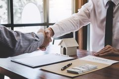 Free Real Estate Broker Agent And Customer Shaking Hands After Signing Contract Documents For Realty Purchase, Bank Employees Stock Photos - 130883463