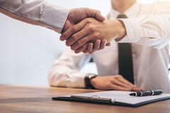 Real estate broker agent and customer shaking hands after signin. G contract documents for realty purchase, Bank employees congratulate, Concept mortgage loan Stock Image