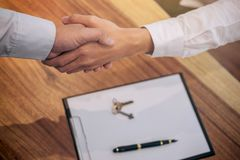 Real estate broker agent and customer shaking hands after signing contract documents for realty purchase, Bank employees royalty free stock photography