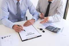 Real estate broker agent presenting and consult to customer to decision making sign insurance form agreement, home model, royalty free stock photography