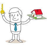 Real estate broker holding key and model house Stock Photos