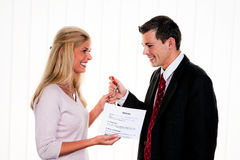 Real estate broker with a house key stock photography