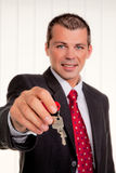 Real estate broker with a house key Stock Photo
