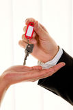 Real estate broker with a house key Royalty Free Stock Image