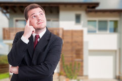 Real estate broker thinking at something Stock Photography