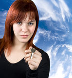 Real estate business. Cute redhead girl giving key for a new home Stock Images