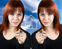 Real estate business concept. Two twin cute redhead girl giving key for a new home Royalty Free Stock Image