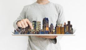 Real estate business and investment, building technology. a man using digital tablet with modern buildings hologram stock photos