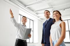 Realtor showing new office room to customers Royalty Free Stock Images