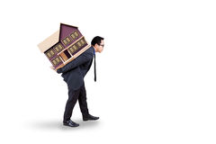 Real estate business with worker carries house Stock Photos