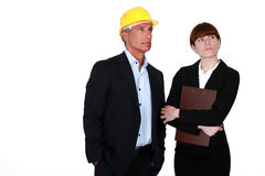 Real estate businessman and assistant. Looking at something Stock Photography