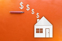 Real Estate and Cash concept on yellow texture background royalty free stock photo
