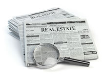 Real estate classifieds ads newspaper  and magnifying glass isol. Ated on white. 3d illustration Royalty Free Stock Images