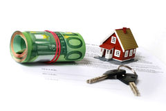 Real estate concept. Keys, money, small house and contract over white royalty free stock photos