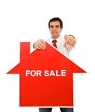 Real estate concept with agent showing sign Royalty Free Stock Photography