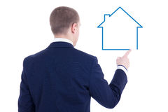 Real estate concept - back view of young business man drawing ho Royalty Free Stock Image