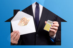 Real estate concept - business man holding envelope with money a Stock Photos