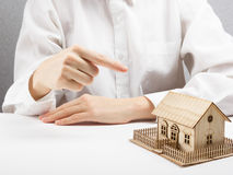 Real estate concept - businessman behind home architectural model Royalty Free Stock Image