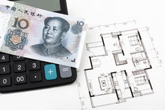 Real estate concept with Chinese money (RMB). Real estate concept with Chinese 10 RMB on a calculator Royalty Free Stock Photos