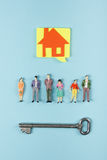 Real Estate concept. Construction building. Blank speech bubbles, people toy figures, paper model house, blueprints with Royalty Free Stock Photos