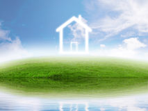 Real estate concept. Eco friendly house on green meadow by the lake Stock Photo