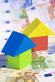 Real Estate concept with Euro banknotes. A real estate investment concept with a toy house surrounded by Euro banknotes Royalty Free Stock Photos
