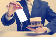 Real estate concept. Hands holding blank business card with keys. Stock Photography