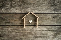 Real estate concept with a heart inside the frame of a house Stock Photos