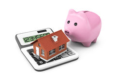 Real Estate Concept. House with calculator and Piggy Bank Royalty Free Stock Images