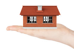 Real Estate Concept. House model in the hand Stock Images